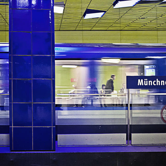 """Munich, Germany - Muenchner Freiheit subway station; train running away in..."" stock image"