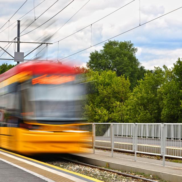 """Streetcar entering the tram stop"" stock image"