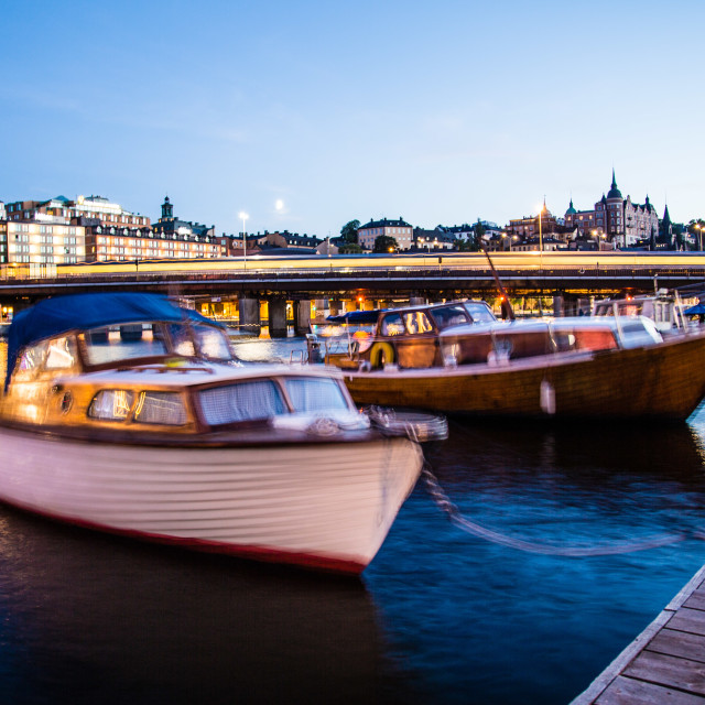"""Boats in Stockholm at night with train"" stock image"