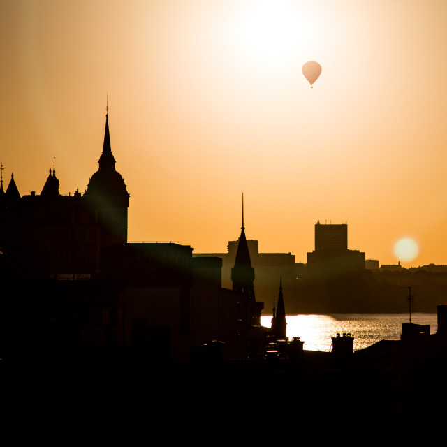 """""""Hot Air Balloon Above Stockholm Skyline Silhouette at Sunset"""" stock image"""