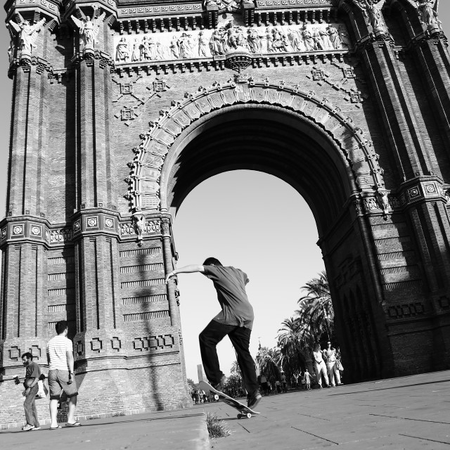 """Skateboarding black and white in Arc de Triomf, Barcelona, Spain"" stock image"