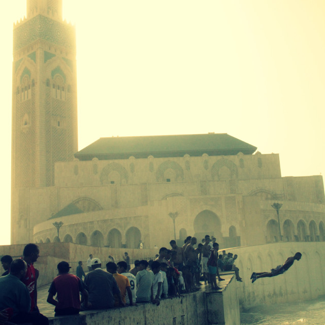 """Diving into sea near Hassan II Mosque, Casablanca"" stock image"