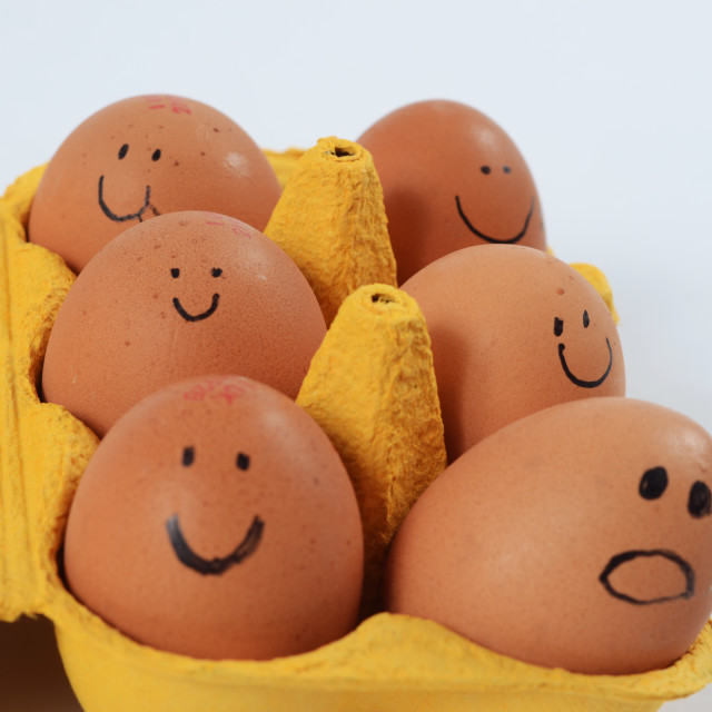 """Carton of Eggs With Faces"" stock image"