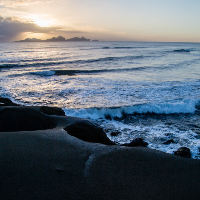 """Rugged coastal sunset of beach in South Iceland"" stock image"