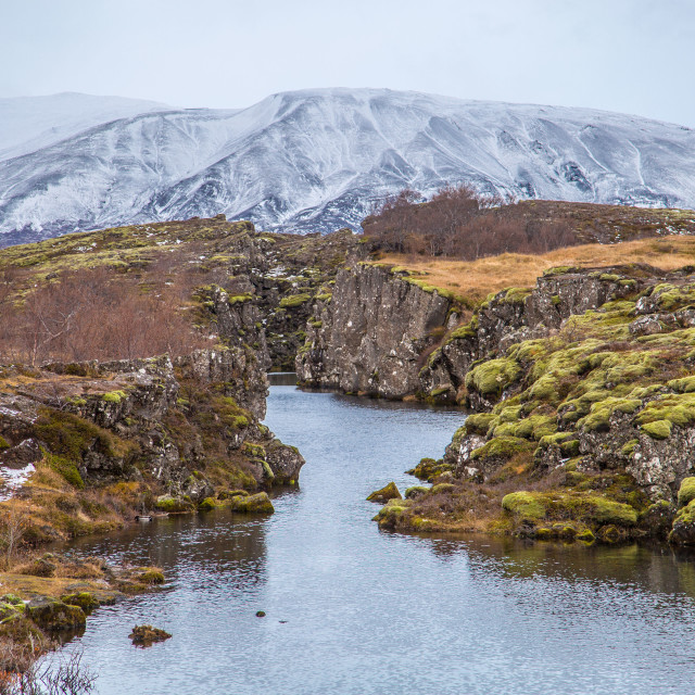 """River with mountains in backdrop 
