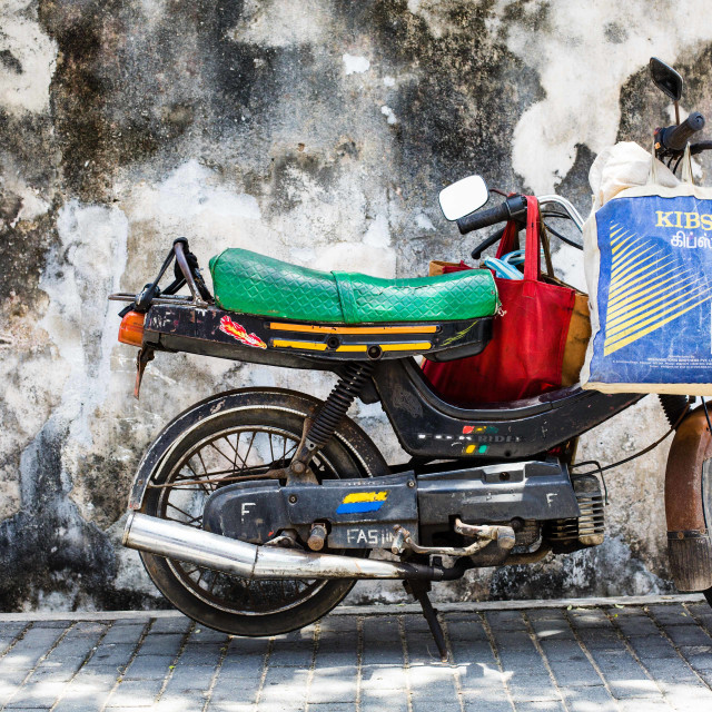 """Colourful motorbike against a textured wall, Galle, Sri Lanka"" stock image"
