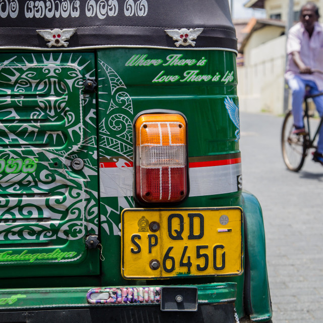 """The back of a tuk tuk with a cyclist, Galle, Sri Lanka"" stock image"