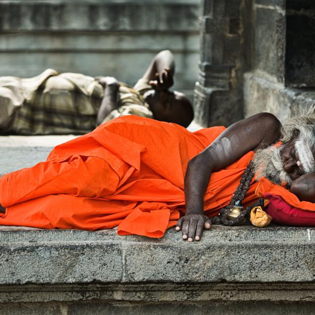 """Sadhu sleeping in temple"" stock image"