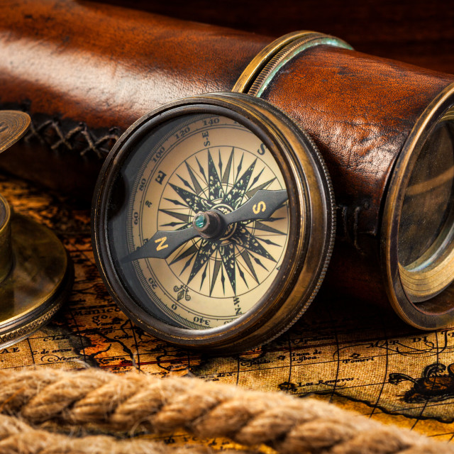 """Old vintage compass and navigation instruments on ancient map"" stock image"