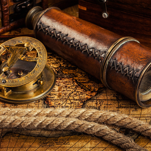 """Old vintage compass on ancient map"" stock image"
