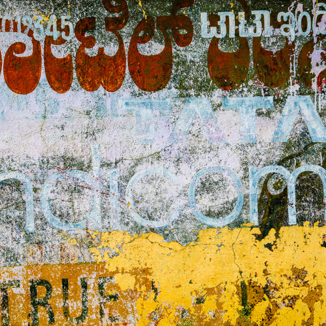 """Texture of Indian graphics and fonts on a wall near Bangalore, India"" stock image"