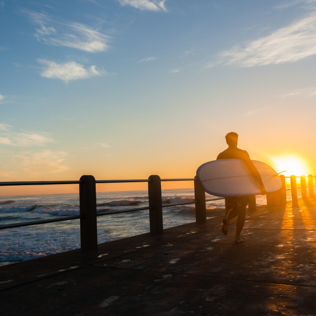 """Surfer Running Pier Sunrise Ocean"" stock image"