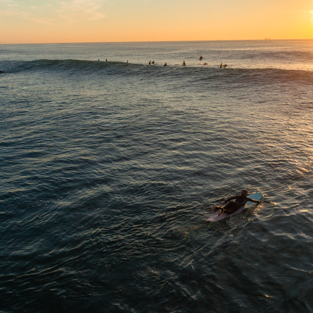 """Surfer Paddling Overhead Dawn Horizon Ocean"" stock image"