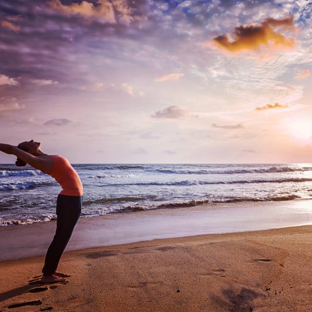 """Young sporty fit woman doing yoga Sun salutation Surya Namaskar"" stock image"