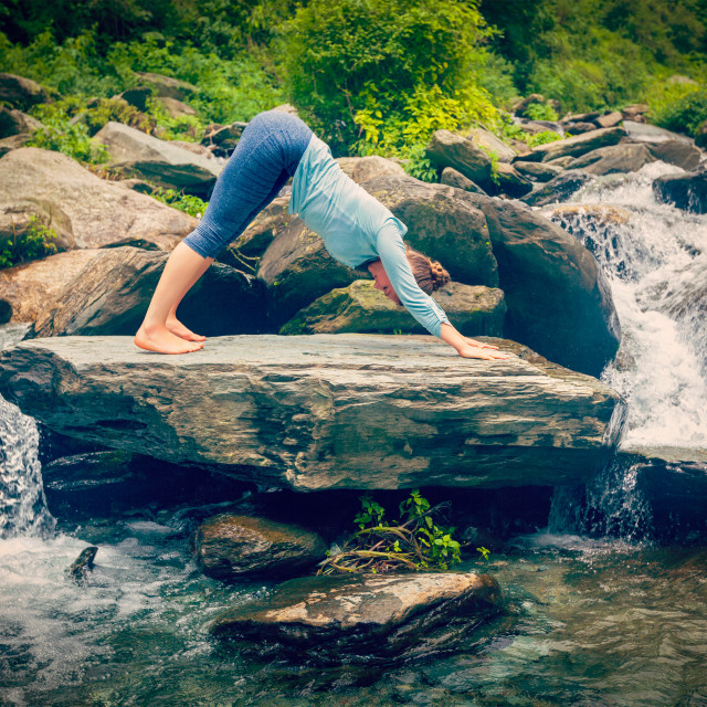 """Young sporty fit woman doing yoga oudoors at tropical waterfall"" stock image"