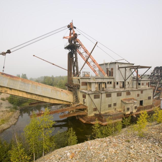 """An abandoned gold dredger on the tundra near Fairbanks Alaska"" stock image"