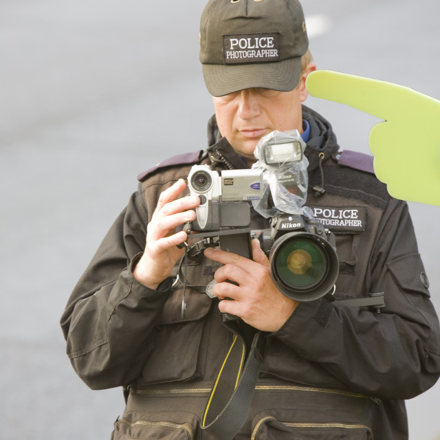 """A police photographer photographing protestors at the Climate camp protest..."" stock image"