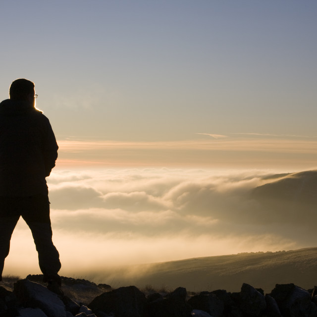 """A walker on the summit of Caudale Moor in the Lake District UK"" stock image"