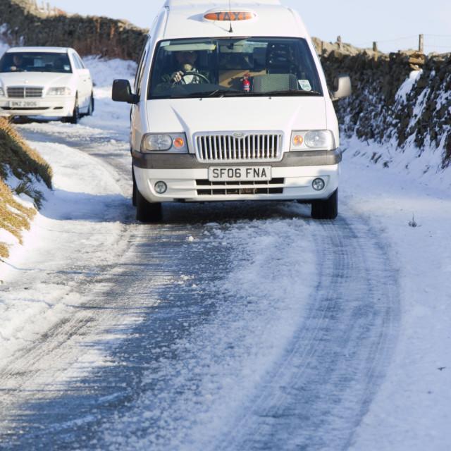 """Cars descending Kirkstone Pass in the Lake District UK"" stock image"