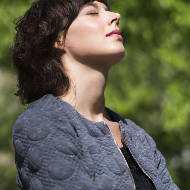 """Daydreaming and enjoying warm sunlight"" stock image"