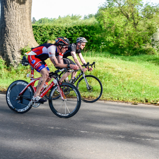 """Southwell,UK:21st May 2017: Cyclists taking part in the Outlaw half.The event consists of a 1.2m swim, 56m bike, 13.1m run .Riders aproching the minster town of Southwell in the Nottinghamshire countryside."" stock image"