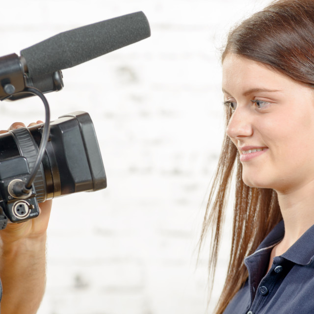 """""""a young woman journalist looks at the camera"""" stock image"""