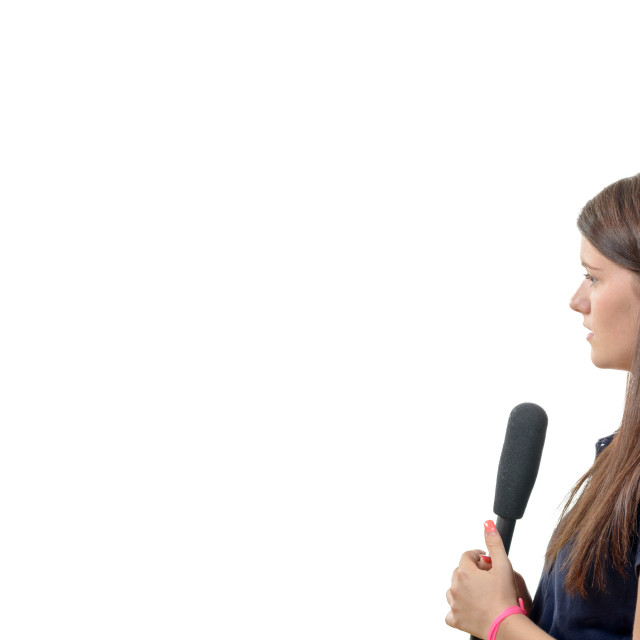 """""""a young woman journalist with a microphone"""" stock image"""
