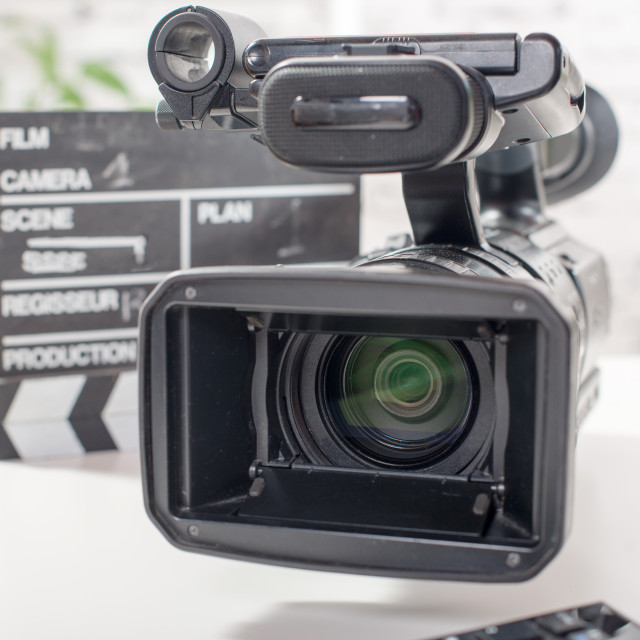 """""""Professional video camera with a clapperboard"""" stock image"""