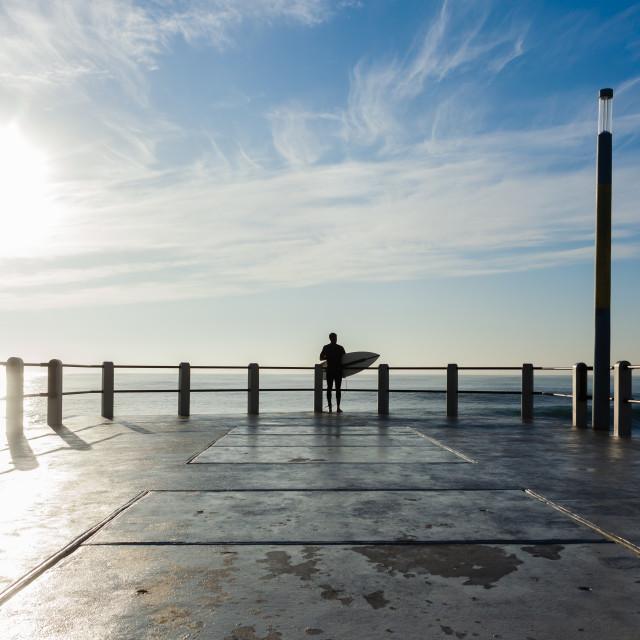 """Surfing Ocean Pier Jump"" stock image"