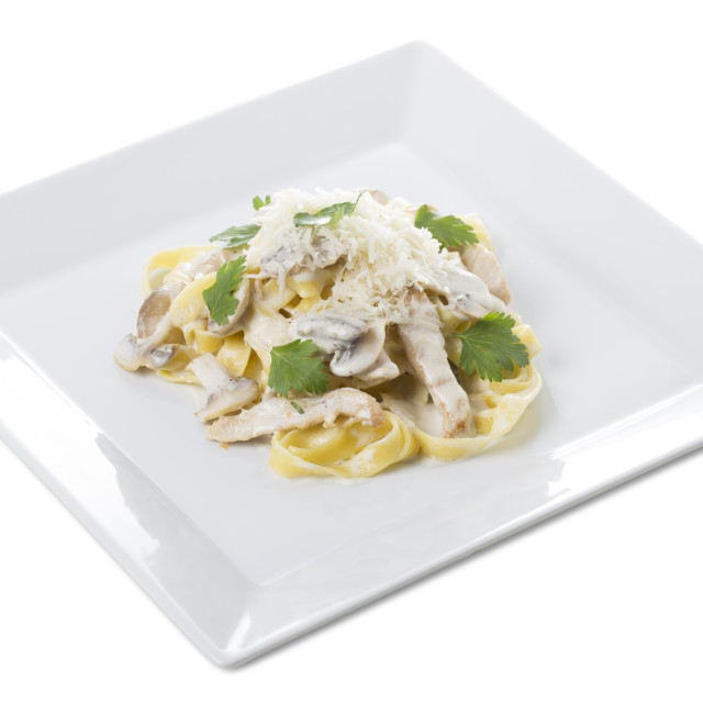 """Fettuccine pasta with chicken fillet and mushrooms."" stock image"