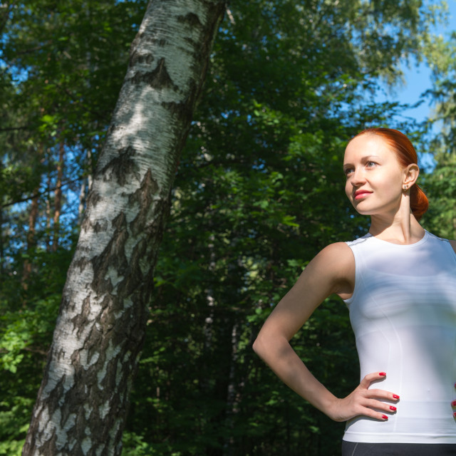 """Young red woman standing in forest"" stock image"