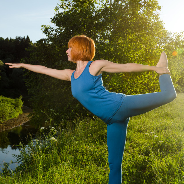 """Red woman practicing fitness yoga"" stock image"