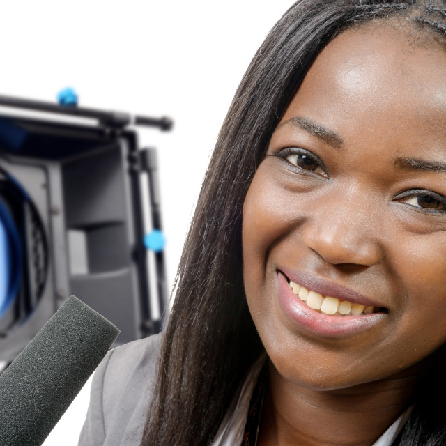 """""""young African american journalist with a microphone and camera"""" stock image"""