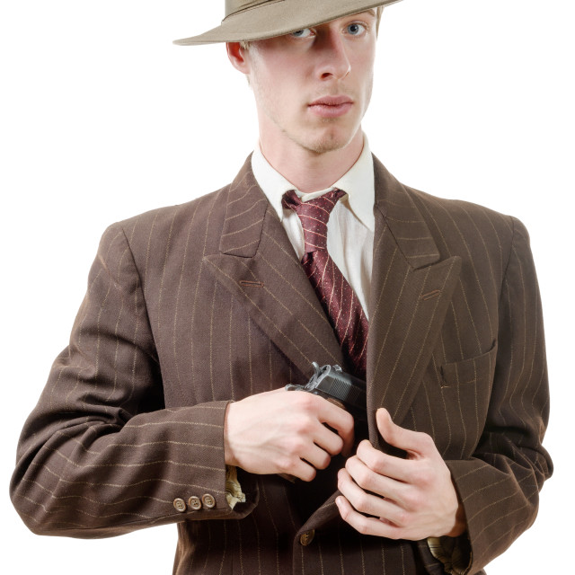 """gangster in a suit vintage, with handgun"" stock image"