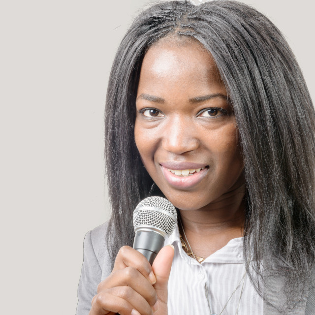 """""""young African american journalist with a microphone"""" stock image"""