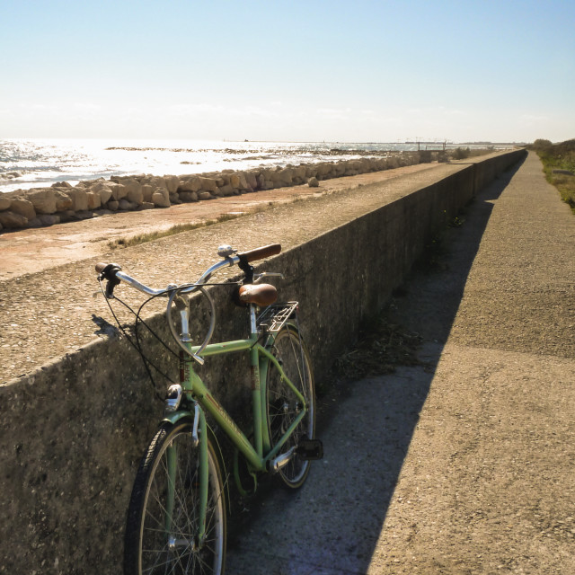 """The bike by the sea"" stock image"