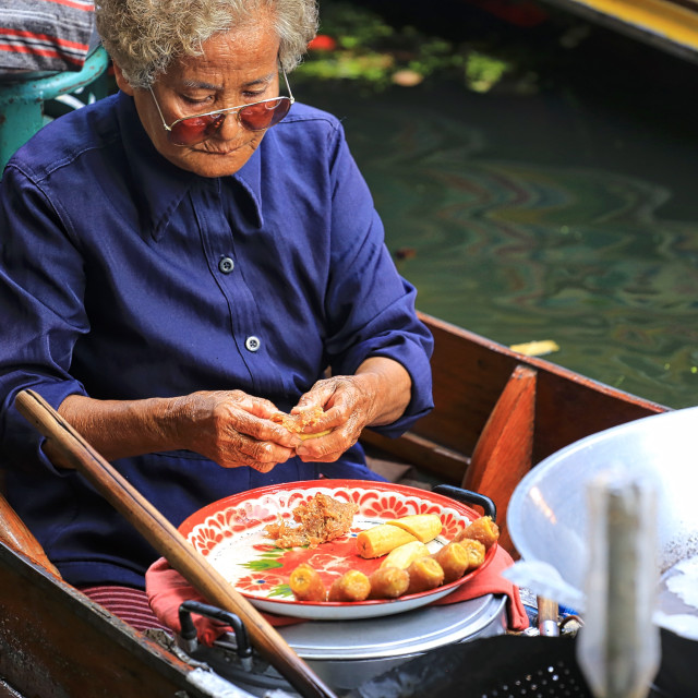 """A dessert vendor of a floating market in Thailand"" stock image"