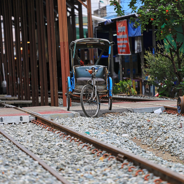 """A lonely trishaw at a railway track"" stock image"