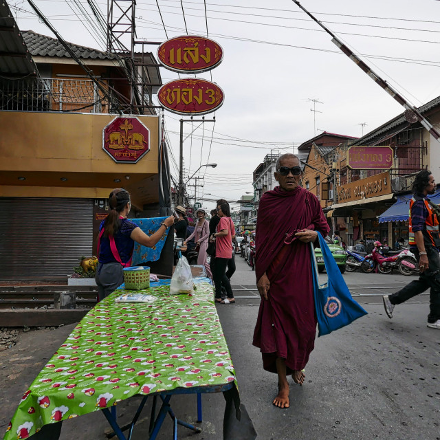 """Monk walking on a street"" stock image"