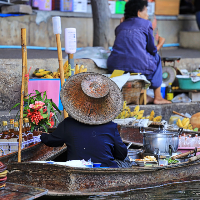 """A lady selling dessert on a boat at floating market"" stock image"