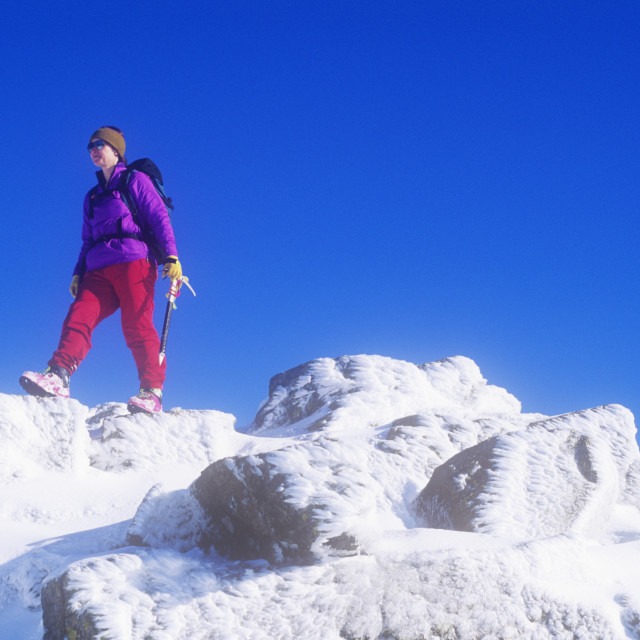 """A woman mountaineer on Crinkle Crags in the Lake district, UK."" stock image"