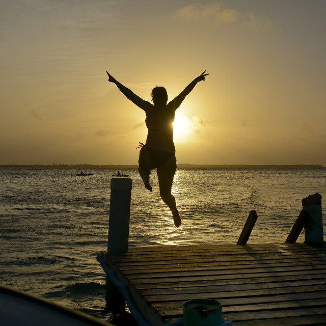 """Sunset leap"" stock image"