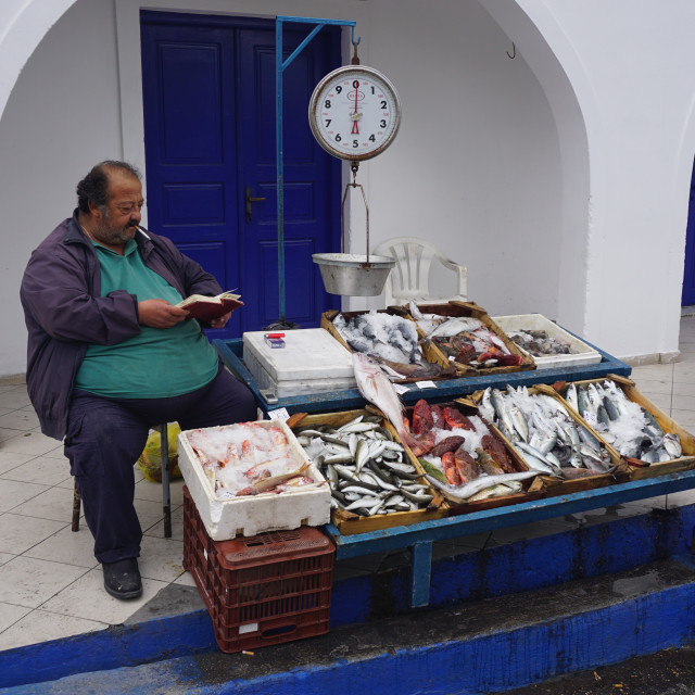 """Fish seller in Santorini"" stock image"