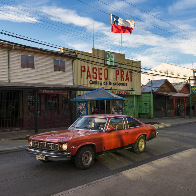 """""""Coyhaique, Chile - November 1, 2013: A red car in a street of the town of Coyhaique in Chile, South America"""" stock image"""