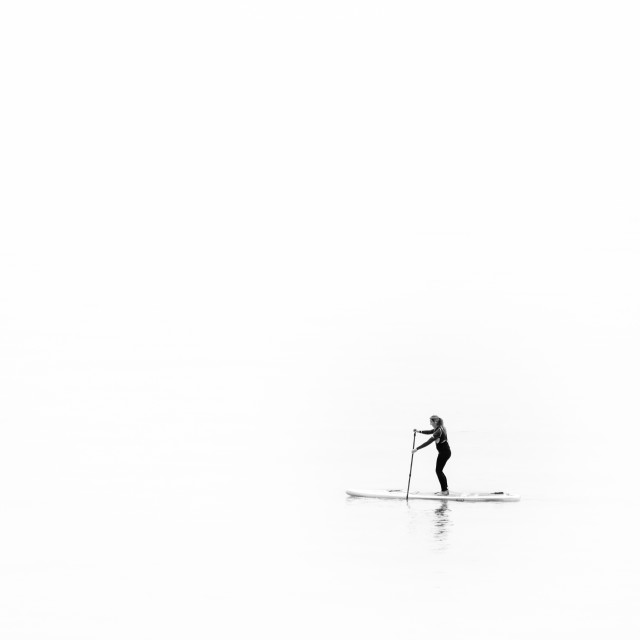 """Lone paddle boarder"" stock image"