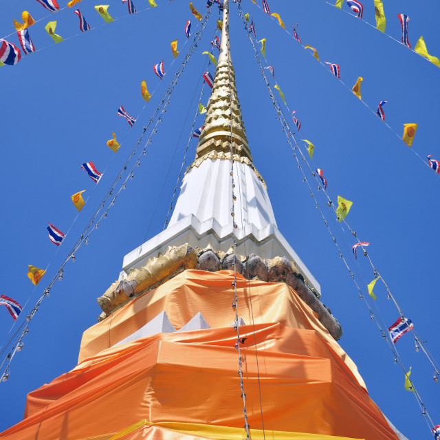 """Stone chedi draped in orange fabric"" stock image"