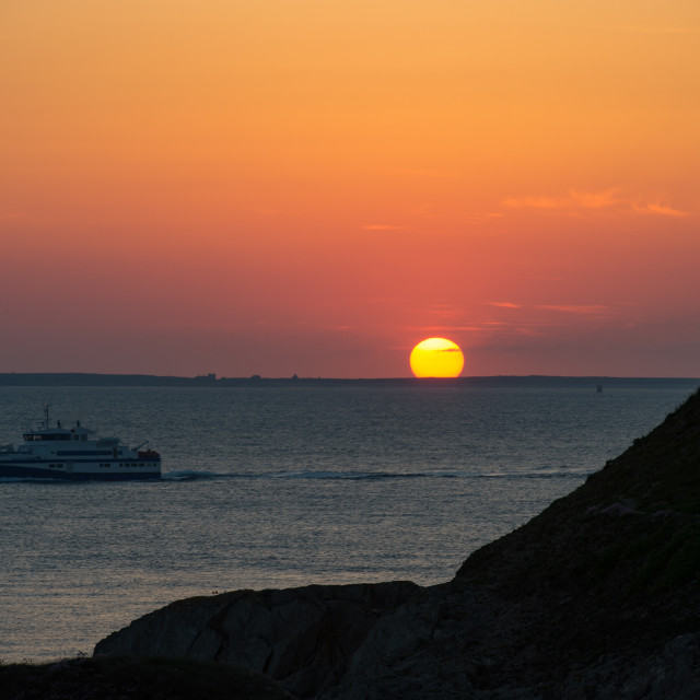 """Sunset, Cruiser boat in silhouette, Brittany"" stock image"
