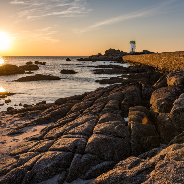 """""""Rocky coast and lighthouse in Trevignonat sunset, Brittany"""" stock image"""