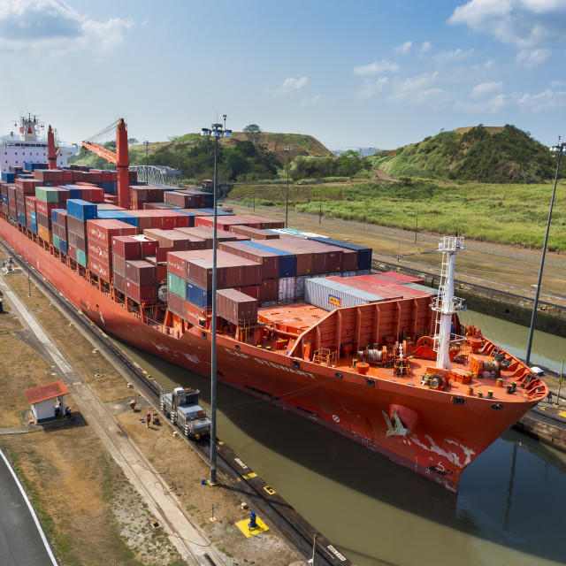 """Panama Canal, Panama - March 17, 2014: Cargo Ship entering the Miraflores Lacks in the Panama Canal in Panama"" stock image"