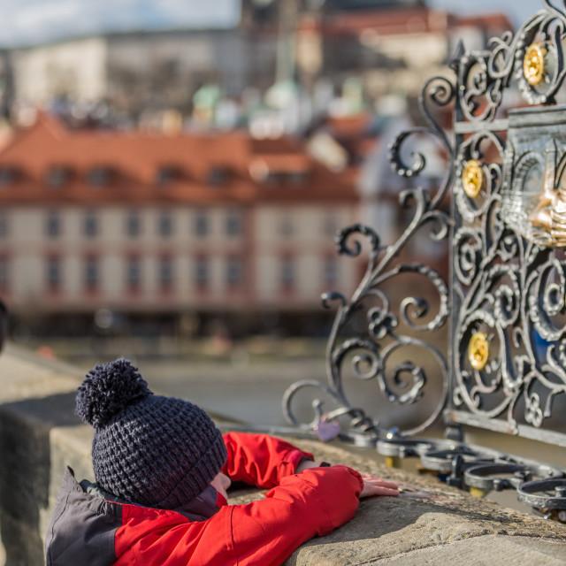 """Child making a wish on Charles Bridge, Prague, Czech Republic"" stock image"